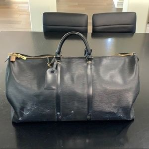Louis Vuitton black Epi duffle bag